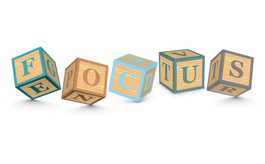 Word FOCUS written with alphabet blocks
