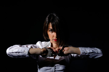 Isolated girl handcuffed girl in trouble on black background