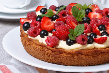 delicious berry tart with strawberries, raspberries, mint