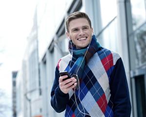 Guy enjoying music on street