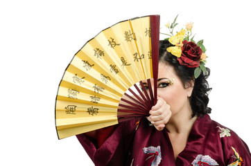 Kimono woman looking at you through the open fan