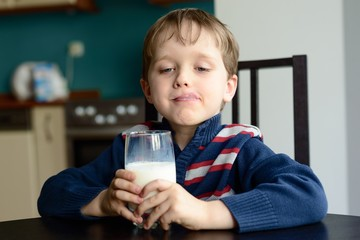 Boy with glass of delicious  milk