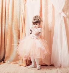 little girl with microphone indoor