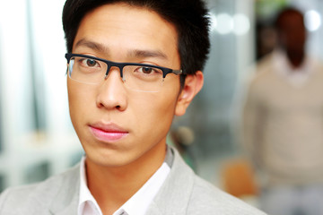 Closeup portrait of a handsome asian man in glasses