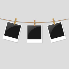 Three blank photos frame hanging on the background
