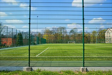 Sport, Soccer field behind the fence