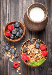 Healthy Breakfast granola muesli with berries and milk