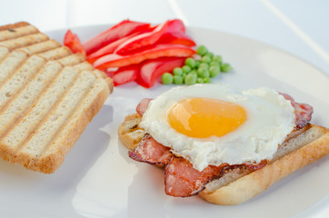 Fresh breakfest - ham, eggs, vegetable and toast