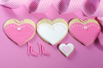 Wedding party bride and groom pink & white cookies favors.