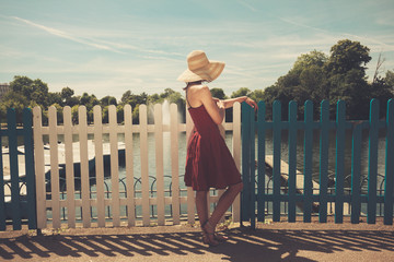 Young woman admiring boating lake
