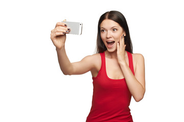 Surprised young girl taking selfie
