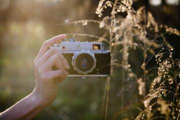 retro camera in hand
