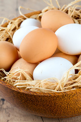 beautiful farm eggs in a wooden bowl