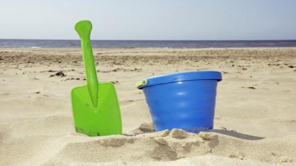 bucket and shovel on the beach