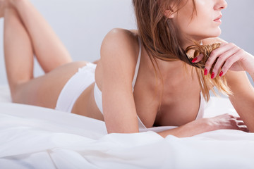 Woman lying  touches her hair