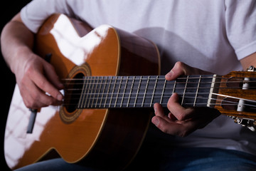 Guitarist hands playing classical guitar