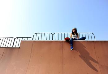 woman skateboarder on saktepark