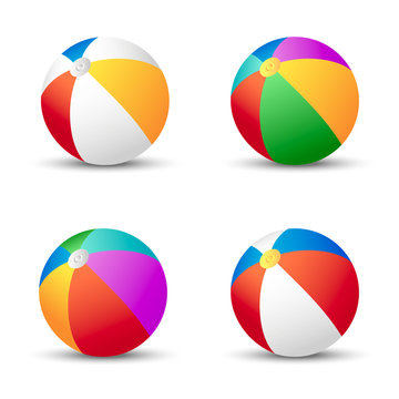 Colorful beach balls isolated on white with shadow.