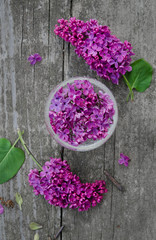 Fresh flowers of lilac on wooden background