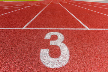 Number three on the start of a running track