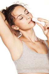 beautiful girl enjoying the scent of her deodorant stick