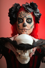 beautiful model with halloween make up sugar skull,.