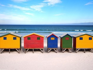 Row of wooden brightly colored huts. South Africa.