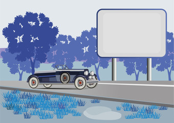 retro car on a background of a landscape and a billboard