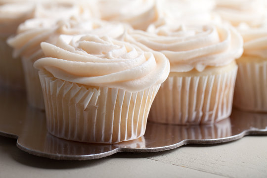 Gourmet strawberry filled cupcakes with white chocolate frosting - side view