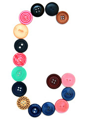 The alphabet from buttons for sewing.