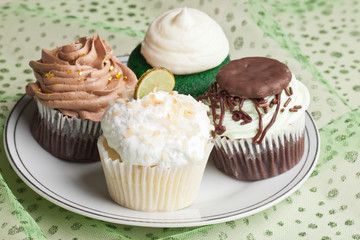 Coconut Key Lime Cupcake, Pot o' Gold chocolate caramel cupcake, Irish Mint cupcake, and Green Velvet cupcake for St. Patrick's Day