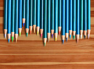 Colored pencils on wood background