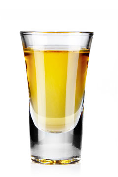 Gold tequila shot isolated on white