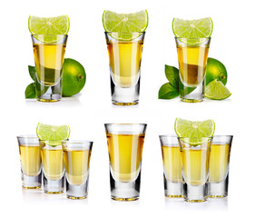 Set of gold tequila shot with lime fruits isolated
