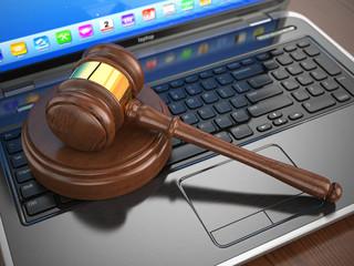 Online internet auction. Gavel on laptop.