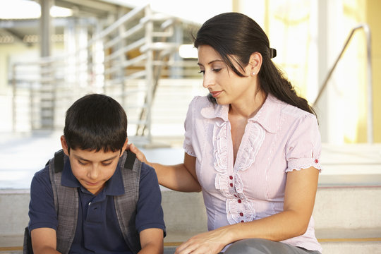 Unhappy Pre teen boy in school