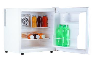 mini fridge full of bottles of juice, soda and fruit isolated