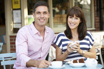 Couple sitting outside café