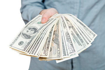 many fanned dollars banknotes in hand