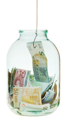 get out saving euro money from glass jar