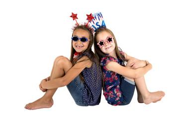 darling USA patriotic girls sitting missing front teeth smiling