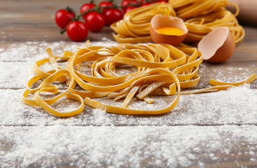 Still life with raw homemade pasta and ingredients for pasta