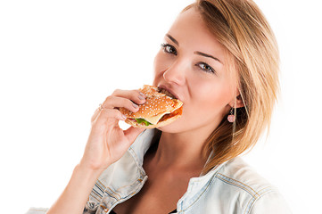 fashionable young woman eating a hamburger isolated on white
