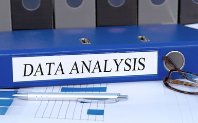 Data Analysis - blue binder with chart in the office