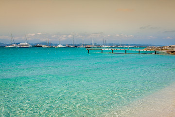 Formentera tropical Mediterranean sea wooden pier in Illetes bea