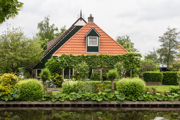 Beautiful traditional house with a thatched roof in Blokzijl Hol