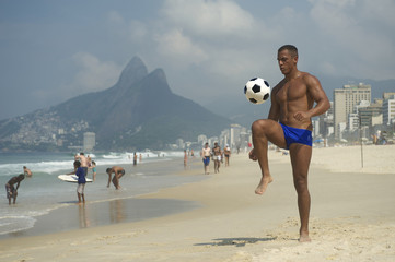 Young Brazilian Man Playing Altinho Beach Football
