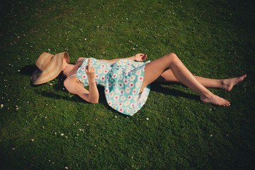 Young woman on grass being rude
