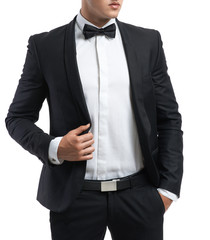 business man in a suit straightens his jacket