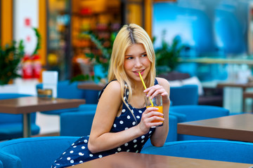 attractive teen girl drinking juice in bar